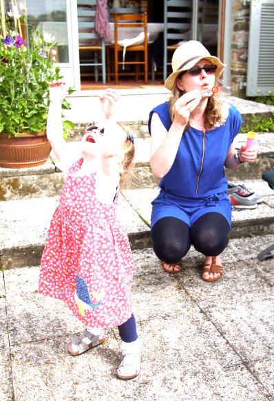 Me in a blue dress (Petit Bateau) blowing bubbles for my birthday girl (25th June 2013)