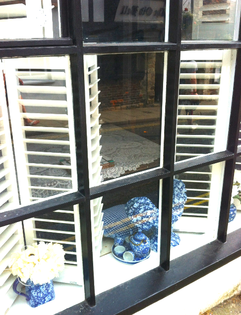 Another gorgeous window display...white shutters and blue and white china...heaven