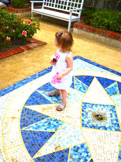 Little G in the rose memorial garden...